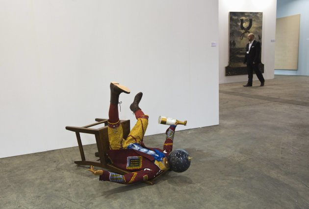 "The sculpture ""Champagne Kid (Fallen)"" by British artist Shonibare is displayed during a preview of the first Art Basel in Hong Kong"