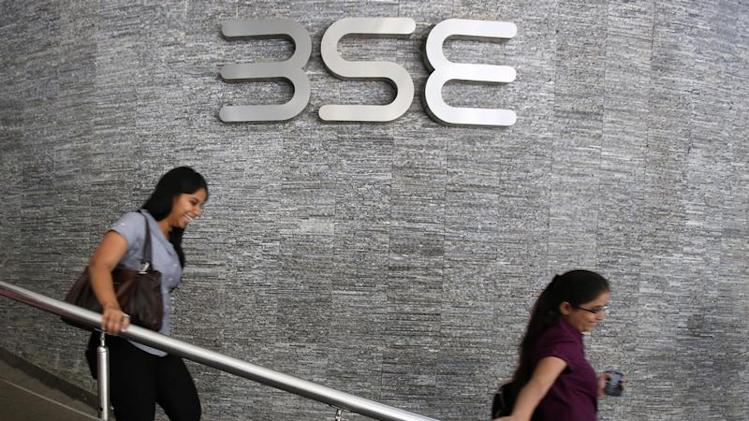 Employees walk in a lobby at BSE during the announcement of the annual budget in Mumbai