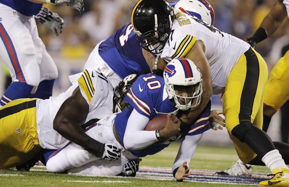 Buffalo Bills quarterback Vince Young is tackled by Pittsburgh Steelers' Cameron Heyward (97) and Corbin Bryant (91) during the second half of a preseason NFL football game in Orchard Park, N.Y., Saturday, Aug. 25, 2012. (AP Photo/Gary Wiepert)
