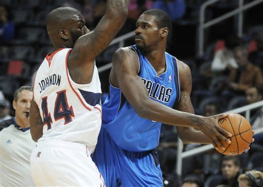 Scott, Johnson lead Atlanta past Mavericks