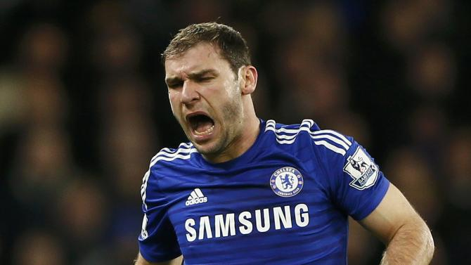 Chelsea's Ivanovic reacts after a challenge during their English League Cup semi-final second leg soccer match against Liverpool in London
