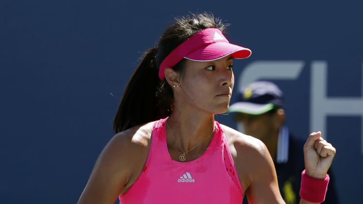 Qiang Wang, of China, reacts after a point against Casey Dellacqua, of Australia, during the second round of the 2014 U.S. Open tennis tournament, Thursday, Aug. 28, 2014, in New York. (AP Photo/Kathy Willens)