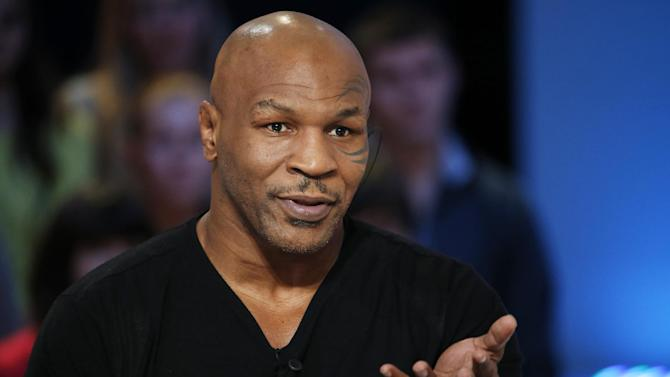 "US Former heavyweight boxing champion Mike Tyson attends the TV show ""Le Grand Journal"" on the French television channel Canal Plus on December 9, 2013 in Paris"