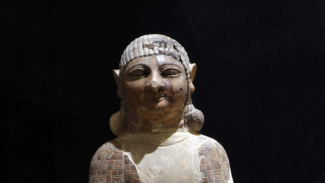 In this Wednesday, April 3, 2013 photo, a statue of a woman from the Kingdom of Nimrod from the ninth century B.C. is displayed at the Iraqi National Museum in Baghdad, Iraq. Ten years after Iraq's national museum was looted and smashed by frenzied thieves during the U.S.-led invasion in 2003 to topple Saddam Hussein, it's still far from ready for a public re-opening. Work to overcome decades of neglect and the destruction of war has been hindered by power struggles, poorly-skilled staff and the persistent violence plaguing the country, said Bahaa Mayah, Iraq's most senior antiquities official.(AP Photo/Hadi Mizban)