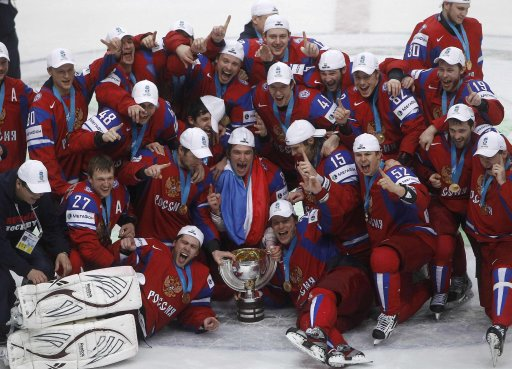Russia's players celebrate winning their 2012 IIHF men's ice hockey World Championship final game against Slovakia in Helsinki