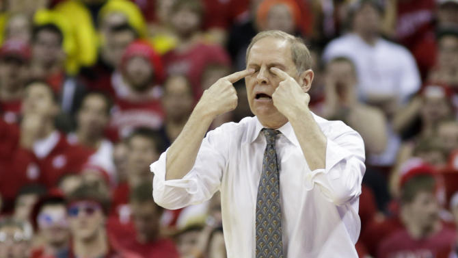 Michigan coach John Beilein gestures during the first half of an NCAA college basketball game against Wisconsin on Saturday, Feb. 9, 2013, in Madison, Wis. Wisconsin upset Michigan 65-62 in overtime. (AP Photo/Andy Manis)