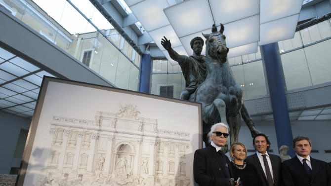 "From left, Designer Karl Lagerfeld, Silvia Venturini Fendi, Fendi CEO Pietro Beccari and Rome's Mayor Gianni Alemanno, pose for photographers next to a drawing of the Trevi Fountain, in Rome, Monday, Jan. 28, 2013. The Fendi fashion house is financing an euro 2.12 million ($2.8 million) restoration of Trevi Fountain in Rome, famed as a setting for the film ""La Dolce Vita'' and the place where dreamers leave their coins. The 20-month project on one of the city's most iconic fountains was being unveiled at a city hall press conference Monday. (AP Photo/Gregorio Borgia)"
