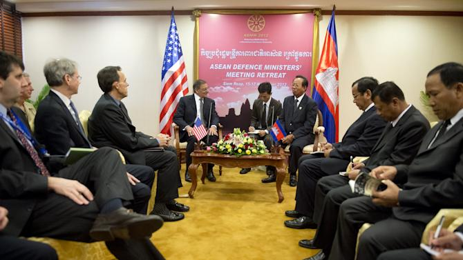 U.S. Secretary of Defense Leon Panetta, center left, speaks with Cambodian Minister of National Defense General Tea Banh, center right, during the ASEAN Defense Ministers Meeting Retreat in Siem Reap,  Cambodia, Friday, Nov. 16, 2012. (AP Photo/Saul Loeb, Pool)