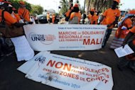 Organisers prepare placards before a march by Senegalese women in Dakar to show their solidarity with the women in Mali on November 30, 2012. Widespread abuses in North Korea and Mali are set to be the subject of heated debate at the 22nd session of the UN Human Rights Council, which kicks off Monday, observers say