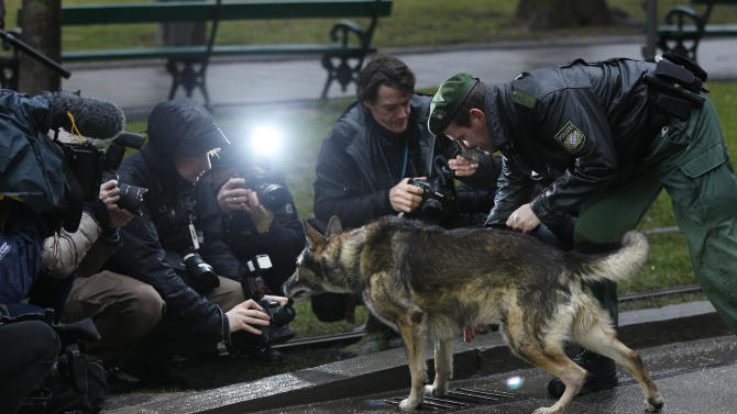 Police officer Christof Hawlik and his dog Dasko pose for photographers in front of the hotel Bayerischer Hof where the Conference on Security Policy takes place in Munich, southern Germany, on Friday, Feb. 1, 2013. The 49th Munich Security Conference starts Friday afternoon with experts from 90 delegations including U.S. Vice President Joe Biden. (AP Photo/Matthias Schrader)