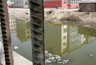 This file photo shows a polluted river, once used for swimming by local youths, in Liukuaizhuang Village in Tianjin, southeast of Beijing, on March 16, 2006. China&#39;s environment ministry has acknowledged the existence of &#39;cancer villages&#39;, several years after widespread speculation first began that polluted areas were seeing a higher incidence of the disease
