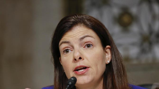 FILE - In this Jan. 13, 2013, file photo, Senate Armed Services Committee member Sen. Kelly Ayotte, R-N.H., speaks at a hearing on Capitol Hill in Washington. Gun control forces are targeting Sens. Ayotte, Max Baucus and others as they struggle to persuade five senators to switch their votes and revive the rejected effort to expand background checks to more firearms buyers. (AP Photo/J. Scott Applewhite, File)