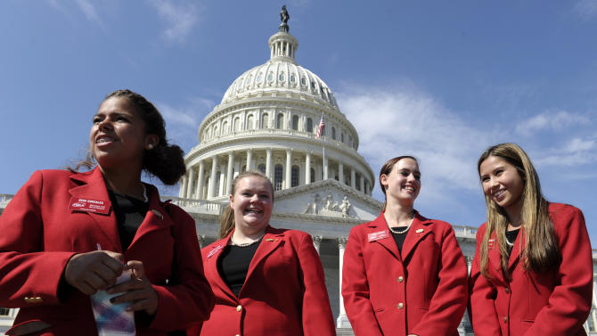 """In this Oct. 1, 2013, photo,. Family, Career and Community Leaders of America from Colorado, from left, Demi Gonzales, Brinslie Lord, Letha Plecker and Katrina San Nicolas, visit the U.S. Capitol in Washington. Tourists are pretty much locked out of Washington's monuments and museums, but those who want to hear lawmakers argue some more about the government shutdown are welcome to it. The group met briefly with congressional staffers whom they described as frazzled by the shutdown, but didn't get the tour they wanted. """"Adults make everything so complicated,"""" said Plecker. """"They just need to work as a team."""" (AP Photo/Susan Walsh)"""