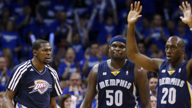 Oklahoma City Thunder forward Kevin Durant, left, reacts to a foul call on Memphis Grizzlies forward Quincy Pondexter (20) as Memphis Grizzlies power forward Zach Randolph (50) walks off the court for a time out in second quarter of Game 1 of their Western Conference Semifinals NBA basketball playoff series in Oklahoma City, Sunday, May 5, 2013. (AP Photo/Sue Ogrocki)