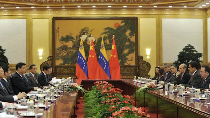 Chinese President Xi Jinping attends a meeting with Venezuelan President Nicolas Maduro at the Great Hall of the People in Beijing