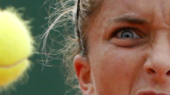 Sara Errani of Italy plays a shot to Alison Riske of the U.S during their women's singles match at the French Open tennis tournament at the Roland Garros stadium in Pari
