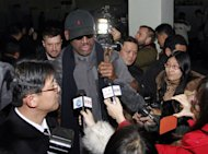 Flamboyant former NBA star Dennis Rodman is surrounded by journalists upon arrival at Pyongyang Airport, North Korea, Tuesday, Feb. 26, 2013. The American known as &quot;The Worm&quot; arrived in Pyongyang, becoming an unlikely ambassador for sports diplomacy at a time of heightened tensions between the U.S. and North Korea. (AP Photo/Kim Kwang Hyon)