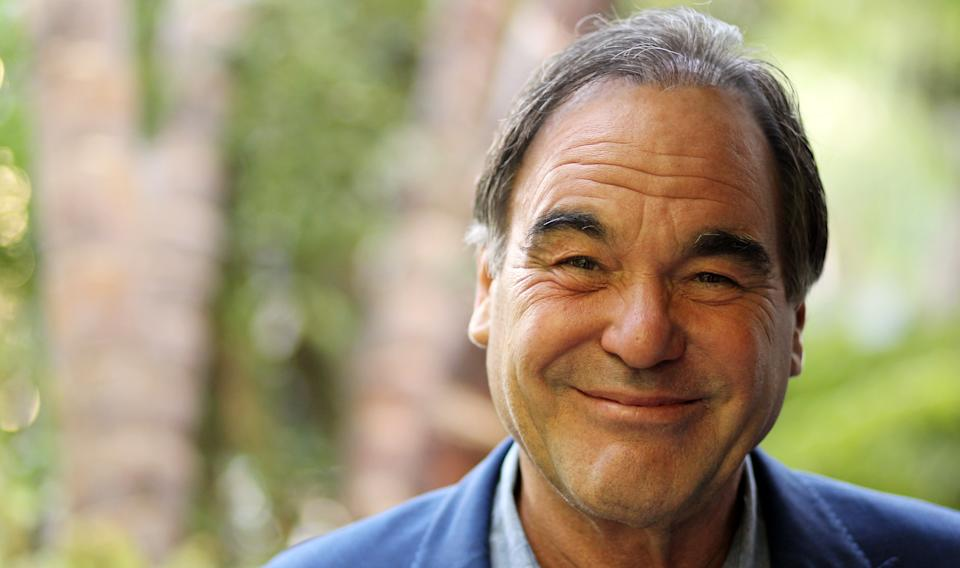 "In this Friday, June 15, 2012 photo, director, Oliver Stone, poses for a portrait in Beverly Hills, Calif. Stone is taking his passion for marijuana to the big-screen with his new drug-war thriller film ""Savages."" (Photo by Matt Sayles/Invision/AP)"