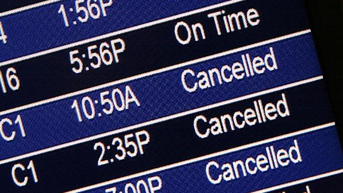 Several departing flights are seen as canceled on the flight status board at Lambert-St. Louis International Airport on Thursday, Feb. 21, 2013.  Blinding snow, at times accompanied by thunder and lightning, bombarded much of the nation's midsection Thursday, causing whiteout conditions, making major roadways all but impassable and shutting down schools and state legislatures. Freezing rain and sleet were forecast for southern Missouri, southern Illinois and Arkansas. St. Louis was expected to get all of the above ,  a treacherous mix of snow, sleet and freezing rain.  (AP Photo/St. Louis Post-Dispatch, Robert Cohen)  EDWARDSVILLE INTELLIGENCER OUT; THE ALTON TELEGRAPH OUT