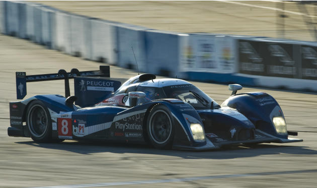 Peugeot Team Total's Stephane Sarrazin, of France, steers the Peugeot 908 through Turn 1 before sunset during the 59th annual American Le Mans Series 12 Hours of Sebring auto race at the Sebring Inter