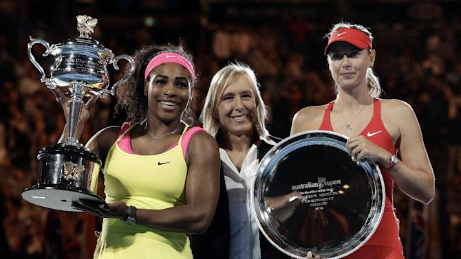 Serena Williams of the U.S., left,  holds the trophy with runner-up Maria Sharapova of Russia, right, with three-time Australian Open champion, Martina Navratilova, in the women's singles final at the Australian Open tennis championship in Melbourne, Australia, Saturday, Jan. 31, 2015. (AP Photo/Bernat Armangue)