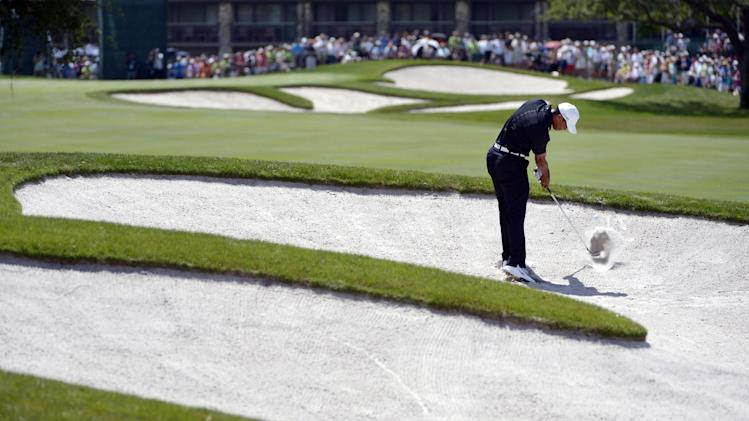 Tiger Woods hits out of a bunker on the ninth fairway during the first round of the Arnold Palmer Invitational golf tournament at Bay Hill in Orlando, Fla., Thursday, March 22, 2012.(AP Photo/Phelan M. Ebenhack)
