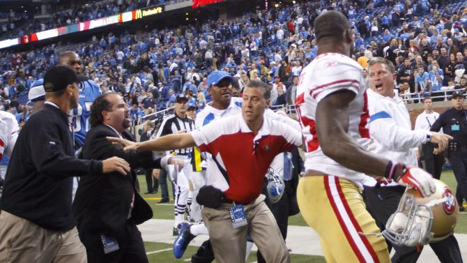 San Francisco 49ers head coach Jim Harbaugh, left, and Detroit Lions head coach Jim Schwartz, right, shout at each other after an NFL football game in Detroit, Sunday, Oct. 16, 2011. The 49ers won 25-19. (AP Photo/Rick Osentoski)