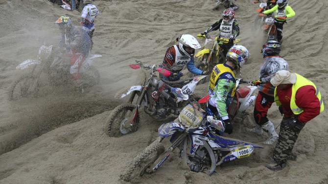 "Bikers are stuck in the sand as they take part in the ""Enduropale"" motorcycle endurance race on the beach of Le Touquet"