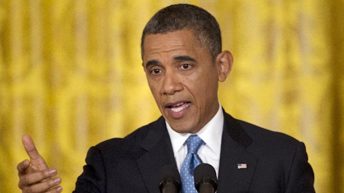 FILE - In this Jan. 14, 2013 file photo, President Barack Obama gestures speaks during his final news conference of his first term in the East Room of the White House in Washington. President Barack Obama's fledgling second term agenda so far reads like a progressive wish list. In less than a week, he's vowed to tackle climate change, expand gay rights and protect government entitlements. His administration lifted a ban on women in combat and expanded opportunities for disabled students. Proposals for stricter gun laws have already been unveiled and plans for comprehensive immigration reform, including a pathway to citizenship for millions of illegal immigrants, are coming soon.  (AP Photo/Carolyn Kaster)