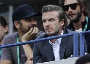 English soccer star David Beckham watches Nadal of Spain face Djokovic of Serbia in the men's final match at the U.S. Open tennis championships in New York