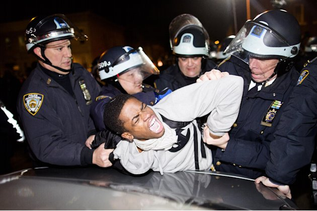 Police officers arrest a demonstrator during a march after a vigil held for Kimani &quot;Kiki&quot; Gray in the East Flatbush neighborhood of Brooklyn, Wednesday, March 13, 2013, in New York. The 16-year-old wa
