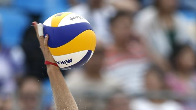 Russia's Rudykh serves against Brazil during their women's semifinal beach volleyball match at the 2014 Nanjing Youth Olympic Games in Nanjing
