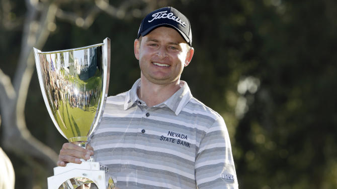 John Merrick holds the trophy after his victory in the Northern Trust Open golf tournament at Riviera Country Club in the Pacific Palisades area of Los Angeles, Sunday, Feb. 17, 2013. (AP Photo/Reed Saxon)