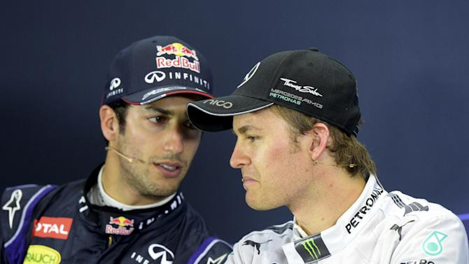 Red Bull driver Daniel Ricciardo of Australia left, and Mercedes driver Nico Rosberg of Germany chat during a press conference after the Australian Formula One Grand Prix at Albert Park in Melbourne, Australia, Sunday, March 16, 2014. Rosberg won the race and Ricciardo finished second. (AP Photo/Mal Fairclough)