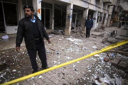 A policeman cordons off the site of a bomb attack at the district court in Islamabad