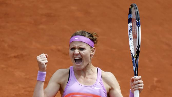 Lucie Safarova of the Czech Republic celebrates after beating Sabine Lisicki of Germany during their women's singles match at the French Open tennis tournament at the Roland Garros stadium in Paris
