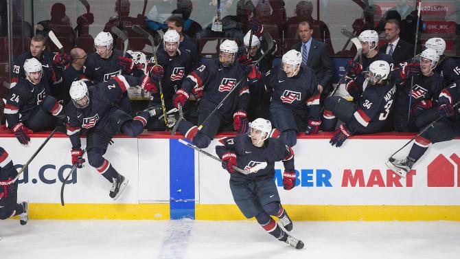 United States players celebrate after defeating Finland in the shootout of a preliminary-round hockey game at the IIHF World Junior Championship in Montreal, Friday, Dec. 26, 2014. (AP Photo/The Canadian Press, Graham Hughes)