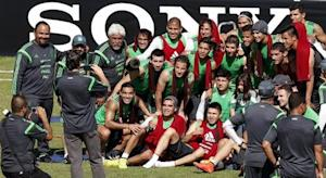 Mexico's national soccer team pose for a photograph after their training session in Santos