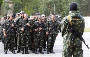 "Members of the ""Donbass"" self-defence battalion attend a ceremony to swear the oath to be officially included into the reserve battalion of the National Guard of Ukraine near Kiev"