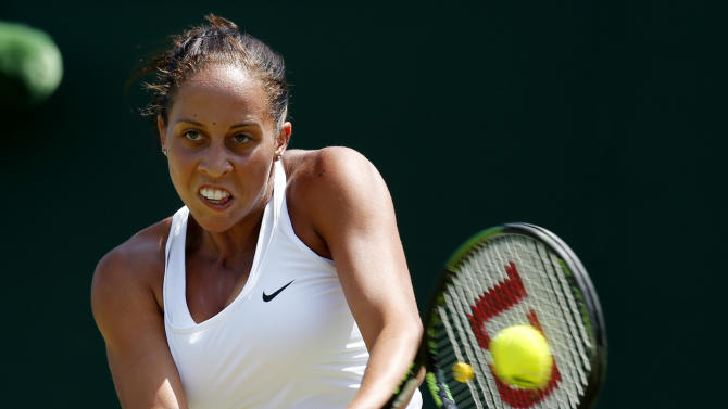 Madison keys of the U.S.A. hits a shot during her match against Tatjana Maria of Germany at the Wimbledon Tennis Championships in London