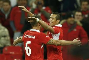 Chile's Sanchez celebrates a second goal against England's with team mate Carmona during their international friendly soccer match at Wembley Stadium in London