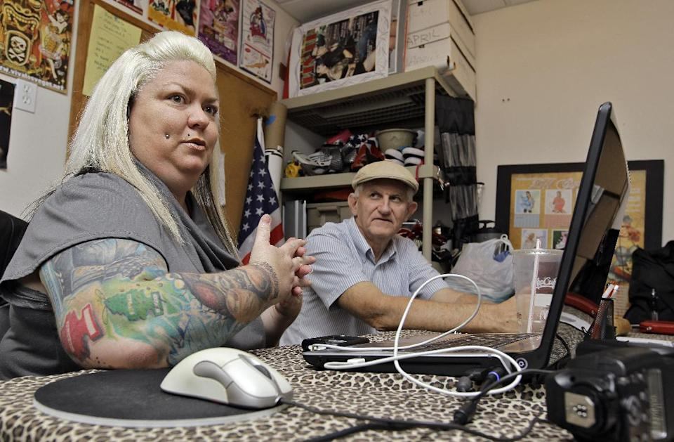 In this March 5, 2012, photo, April Catalano, right, and Richard Strawn, known as Momma and Poppa Pinup answer questions during an interview in their Ybor City studio in Tampa, Fla. (AP Photo/Chris O'Meara)