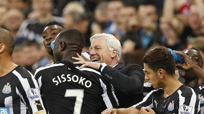 Newcastle United manager (C) celebrates with goal scorer Newcastle United's Sissoko during their English Premier League soccer match in Newcastle