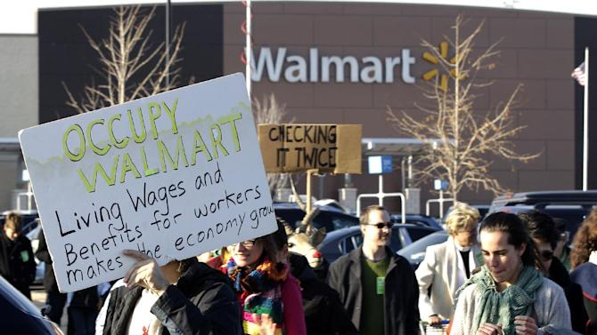 People protest against Wal-Mart on Black Friday, Nov 23, 2012, in Secaucus, N.J.  Wal-Mart employees and union supporters are taking part in today's nationwide demonstration for better pay and benefits. A union-backed group called OUR Walmart, which includes former and current workers, was staging the demonstrations and walkouts at hundreds of stores on Black Friday, the day when retailers traditionally turn a profit for the year. (AP Photo/Mel Evans)