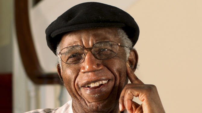 "This undated photo provided by Brown University shows Chinua Achebe at his home in Warwick, R.I. Achebe, an internationally celebrated Nigerian author, statesman and dissident, has died at age 82. Achebe's 1958 novel, ""Things Fall Apart,"" is widely regarded as the first major work of modern African fiction and inspired others to tell the continent's story through the eyes of those who lived there. He joined Brown University in 2009 as a professor of languages and literature. (AP Photo/Brown University, Mike Cohea)"