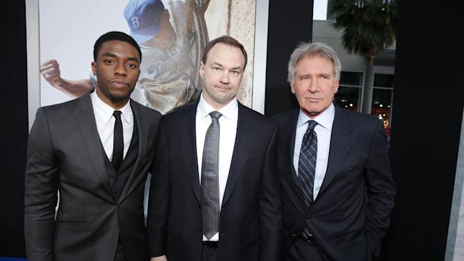 """Chawick Boseman, Producer Thomas Tull and Harrison Ford at The Los Angeles Premiere of Warner Bros. Pictures' and Legendary Pictures' """"42"""", on Tuesday, April, 9th, 2013 in Los Angeles. (Photo by Eric Charbonneau/Invision for Warner Bros./AP Images)"""