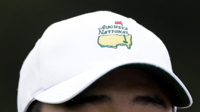 Amateur Guan Tianlang, of China, wears an Augusta National golf course hat while competing in the second round of the Masters golf tournament Friday, April 12, 2013, in Augusta, Ga. (AP Photo/Charlie Riedel)