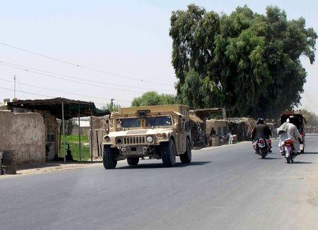 Afghan forces regain control of a symbolic district in south