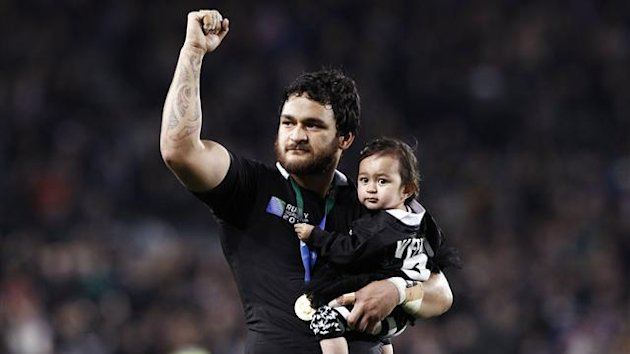 New Zealand All Blacks' Piri Weepu celebrates with his daughter Keira after beating France to win the Rugby World Cup final at Eden Park