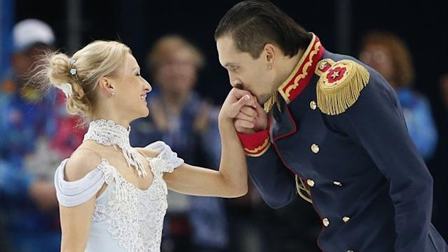 Maxim Trankov kisses the hand ofTatiana Volosozhar of Russia at the end of their performance during the Team Pairs Short Program at the Sochi 2014 Winter Olympics (Reuters)
